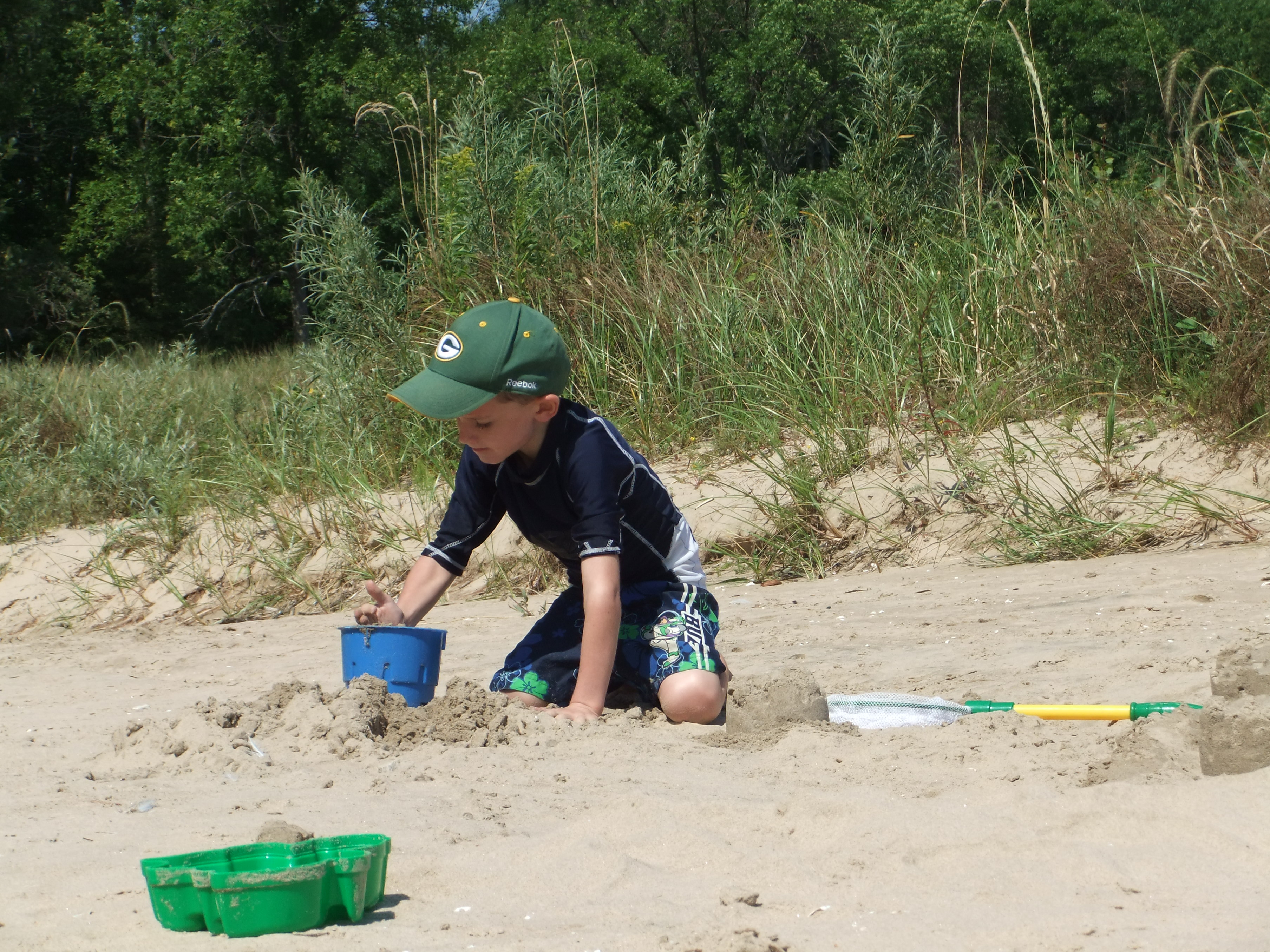 Playing in the sand at Harrington Beach State Park.