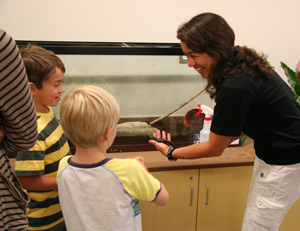 Children get a hands on experience with our animals at Menomonee Valley