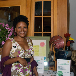 Woman standing next to a table of auction items