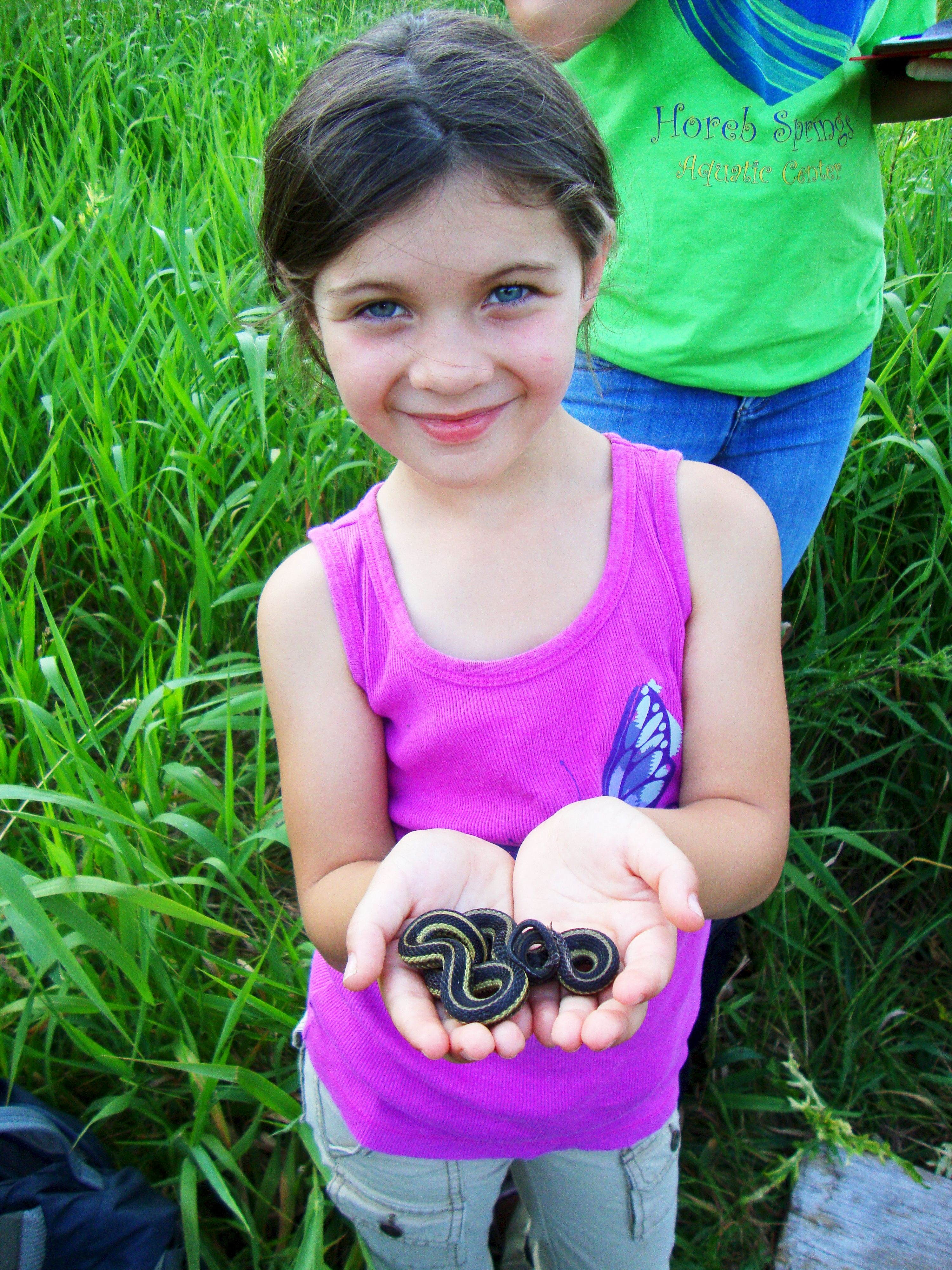 Young girl holding snake
