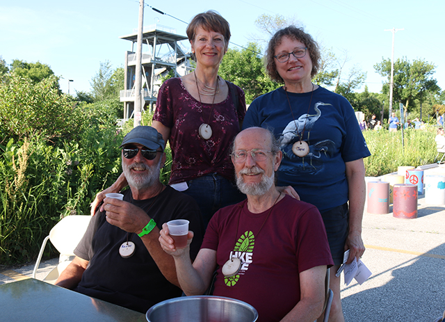 Dennis, his wife Jane, and friends sharing a beer at UEC's Grown Up Summer Camp