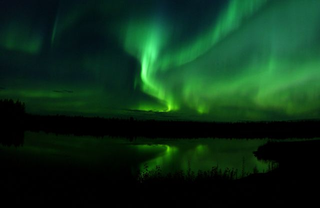 The Aurora Borealis or Northern Lights shine above Bear Lake in Alaska 050910 F MS415 009