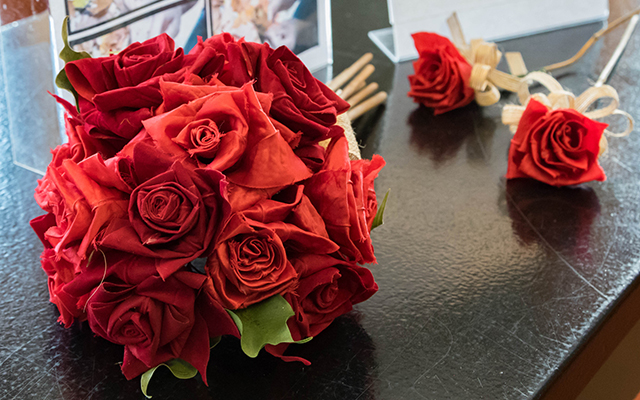 Paper roses in a bouquet and matching paper rose boutonnieres