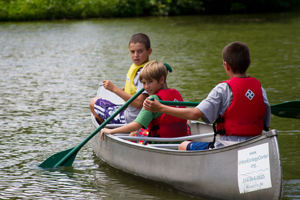 Boys take a canoe for a spin at a B'earthday Party