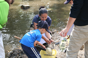 Alejandra working in the river with kids