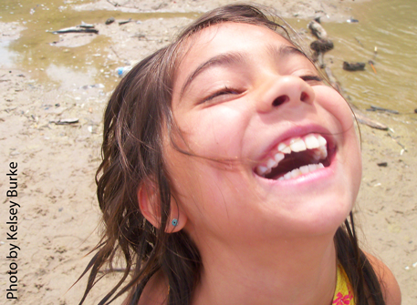 Laughing girl on the beach