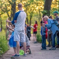 Community scientists searching for fireflies at Riverside Park.